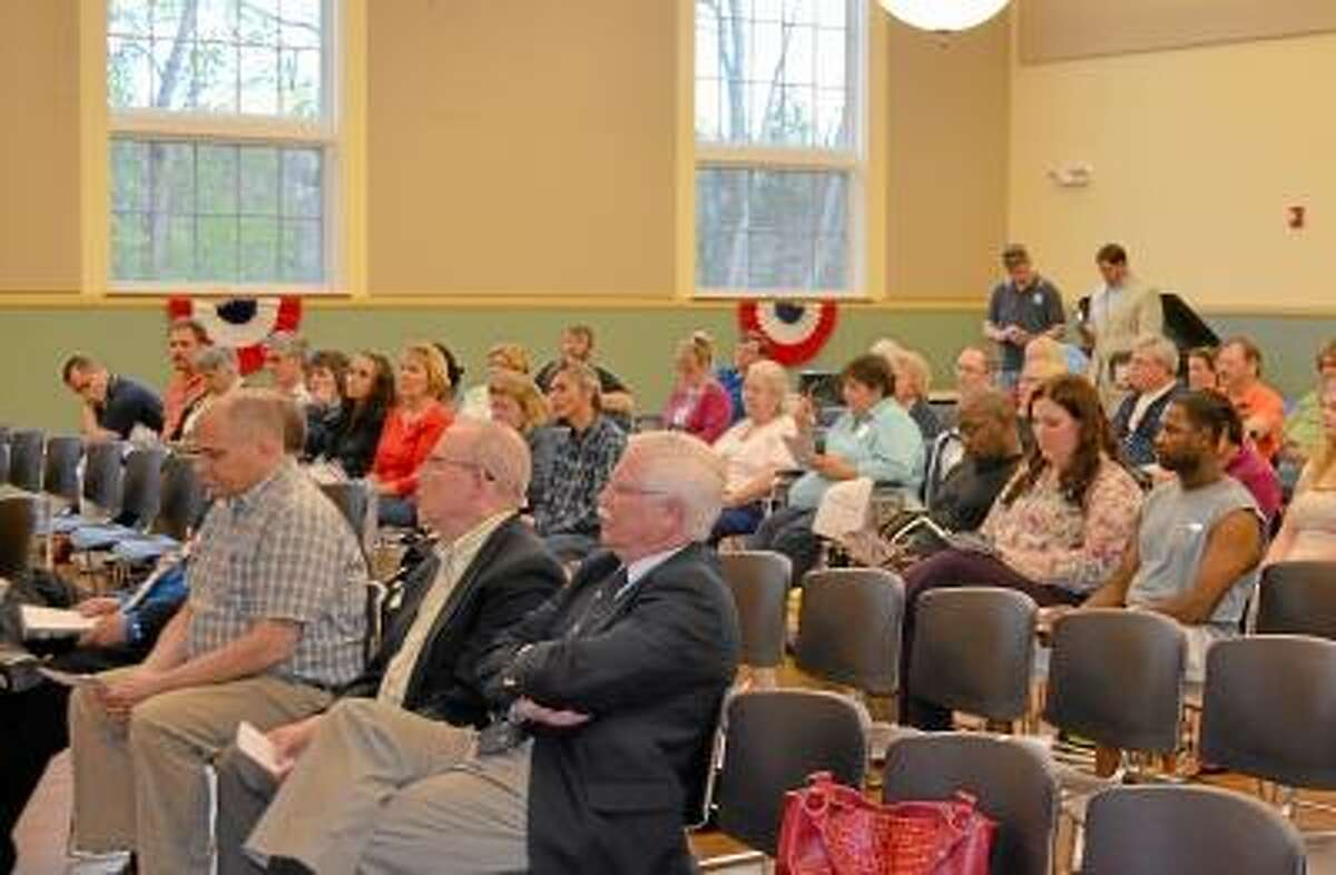 Kate Hartman/Register Citizen -- A crowd gathers at Torrington City Hall to celebrate National Prayer Day on Thursday, May 2.