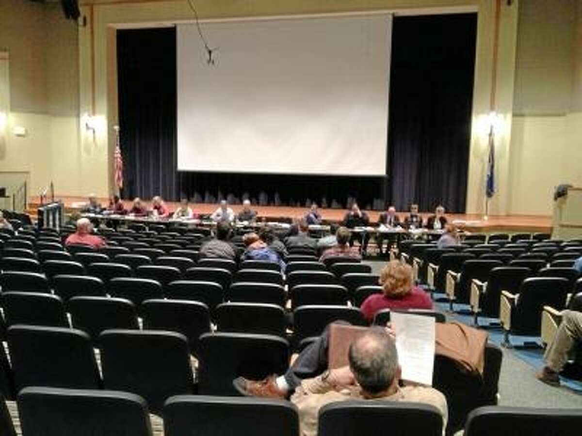JASON SIEDZIK/Register Citizen Residents hear the details of Region 10's proposed budget for 2013-14.