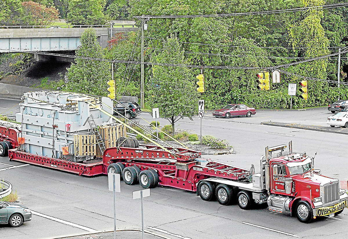 An autotransformer on a hauler moves through Southbury in 2009. A similar hauler will roll through Western Connecticut to Torrington next week.