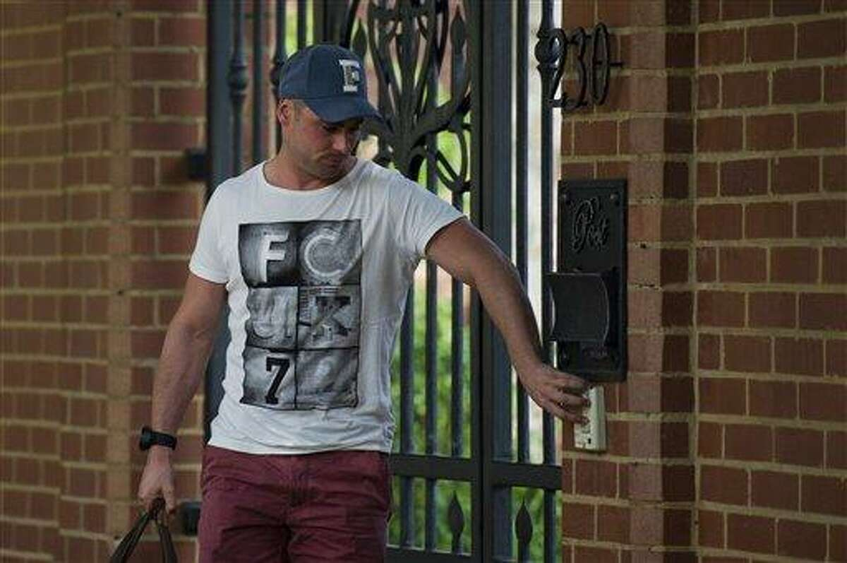 Carl Pistorius, brother of Olympian athlete, Oscar Pistorius, arrives at home, Sunday Feb. 24, 2013, where his brother has been staying in Pretoria, South Africa, since being granted bail Friday for the Valentine's Day shooting death of his girlfriend, Reeva Steenkamp. Reports emerged Sunday that Carl Pistorius is facing charges of culpable homicide for the death of a woman biker who was knocked down in 2010. (AP Photo)