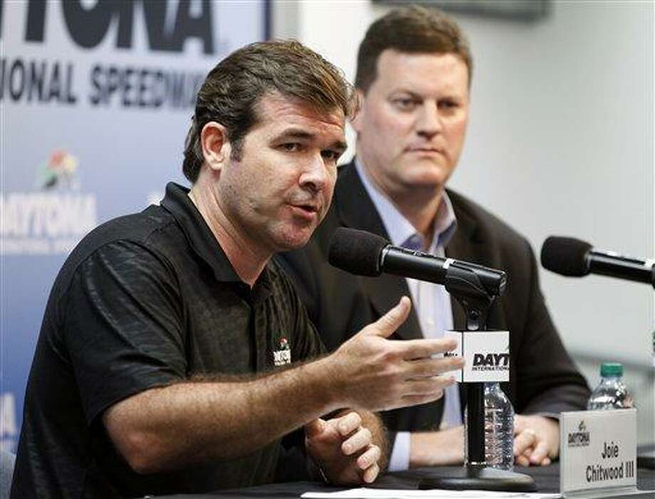 Daytona International Speedway president Joie Chitwood III, left, speaks at news conference with Steve O'Donnell, NASCAR senior vice president, after numerous spectators were injured when driver Kyle Larson's car crashed in a catch fence on the last lap of the NASCAR Nationwide Series auto race Saturday, Feb. 23, 2013, in Daytona Beach, Fla. Larson's crash sent car parts and other debris flying into the stands. (AP Photo/Terry Renna) Photo: AP / FR60642 AP