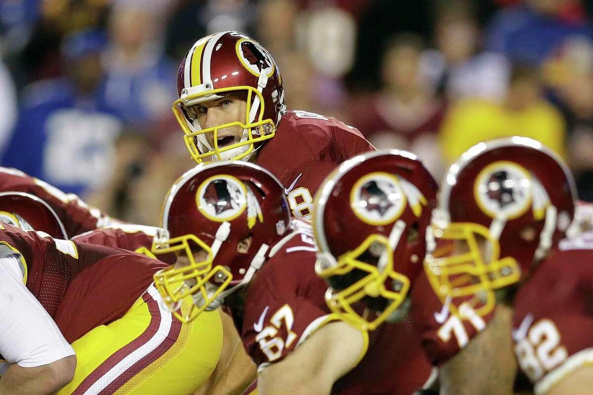 Washington quarterback Kirk Cousins (8) looks down the line during the first half Thursday.