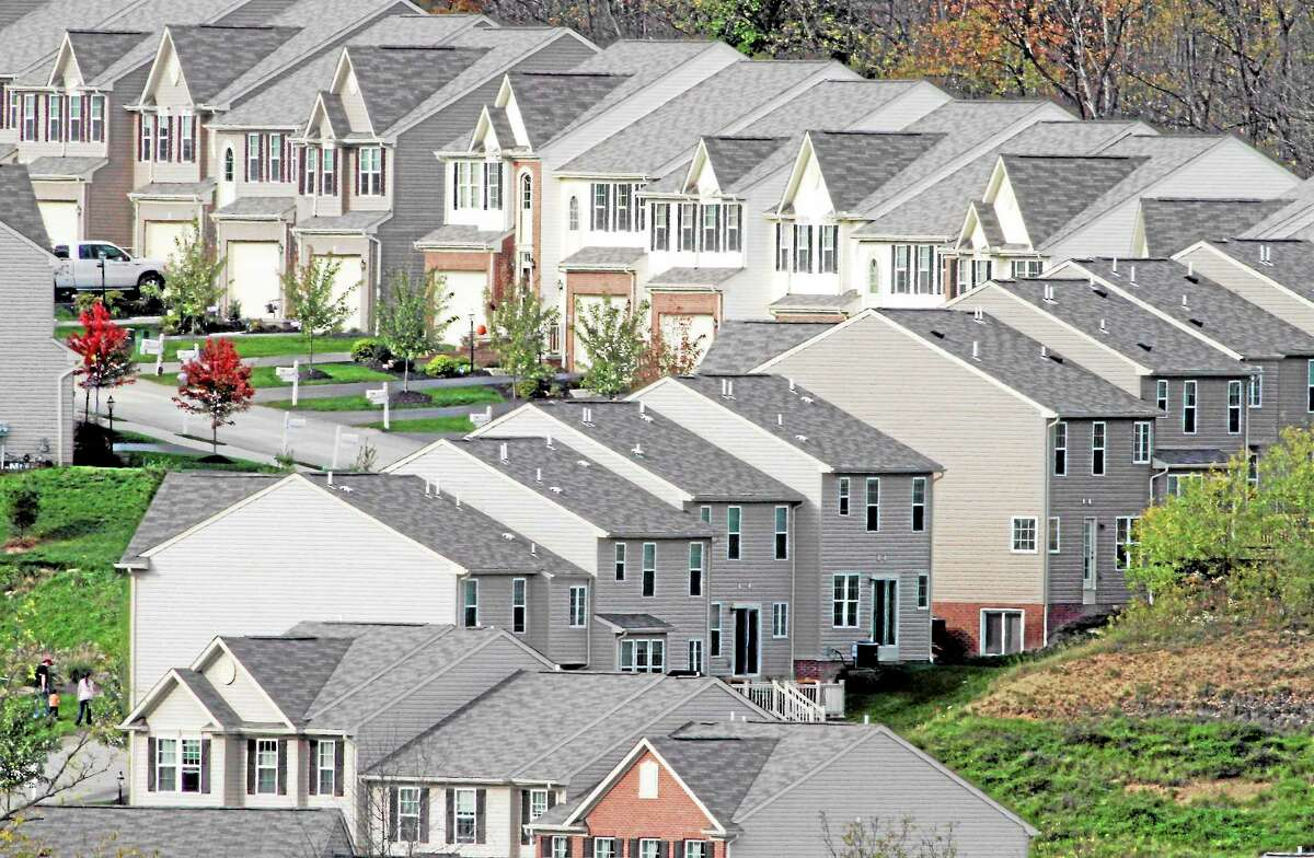 A new home development is photographed in Canonsburg, Pa., Tuesday, Oct. 18, 2011. Builders broke ground on more homes in September, but permits for future construction fell, a grim sign for the housing market.