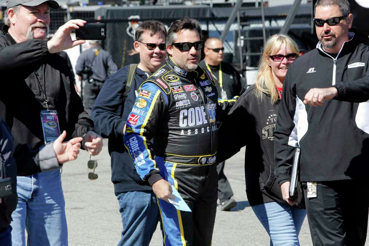 Driver Tony Stewart arrives for practice for Sunday's NASCAR Sprint Cup race at New Hampshire Motor Speedway on Friday in Loudon, N.H.