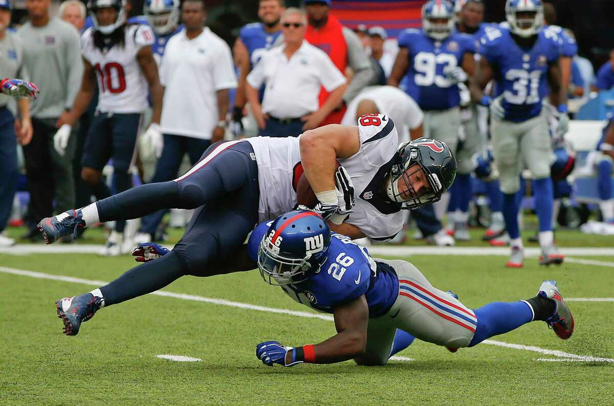 Houston Texans tight end Garrett Graham (88) is upended by New York Giants strong safety Antrel Rolle in the fourth quarter of Sunday's game in East Rutherford, N.J.