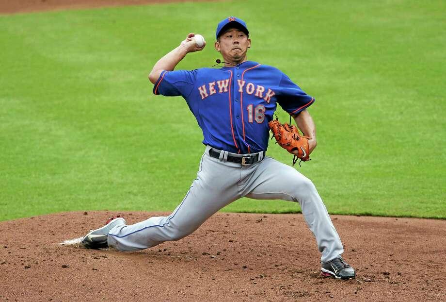 New York Mets starting pitcher Daisuke Matsuzaka (16) works in the first inning of a baseball game against the Atlanta Braves, Monday, Sept. 2, 2013 in Atlanta. (AP Photo/John Bazemore) Photo: AP / AP