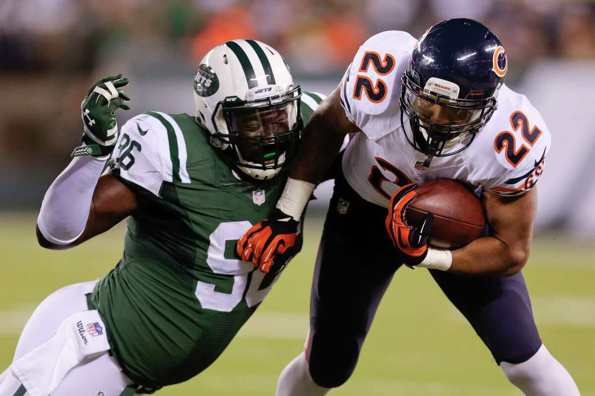 Chicago Bears running back Matt Forte (22) carries the ball against New York Jets defensive end Muhammad Wilkerson (96) during the second quarter of Monday's game in East Rutherford, N.J.