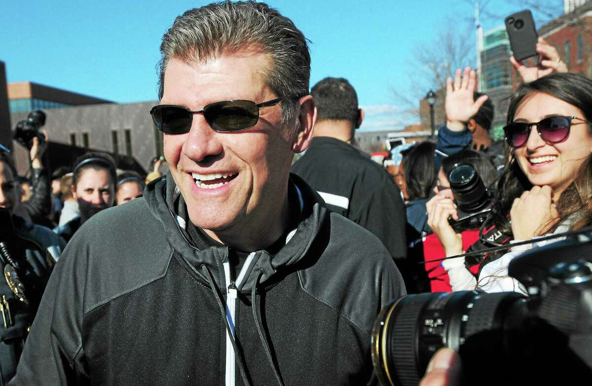 UConn coach Geno Auriemma mingles with fans as the Huskies get welcomed back to Storrs on April 9 after winning the national championship.