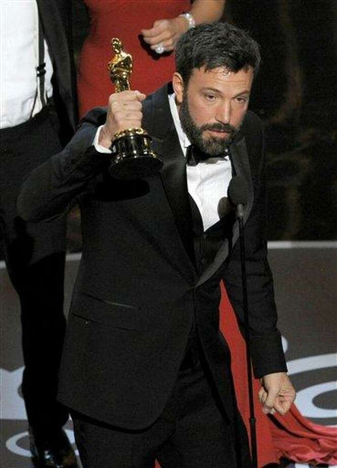 """Ben Affleck accepts the award for best picture for """"Argo"""" during the Oscars at the Dolby Theatre on Sunday Feb. 24, 2013, in Los Angeles.  (Photo by Chris Pizzello/Invision/AP) Photo: Chris Pizzello/Invision/AP / The Associated Press2013"""