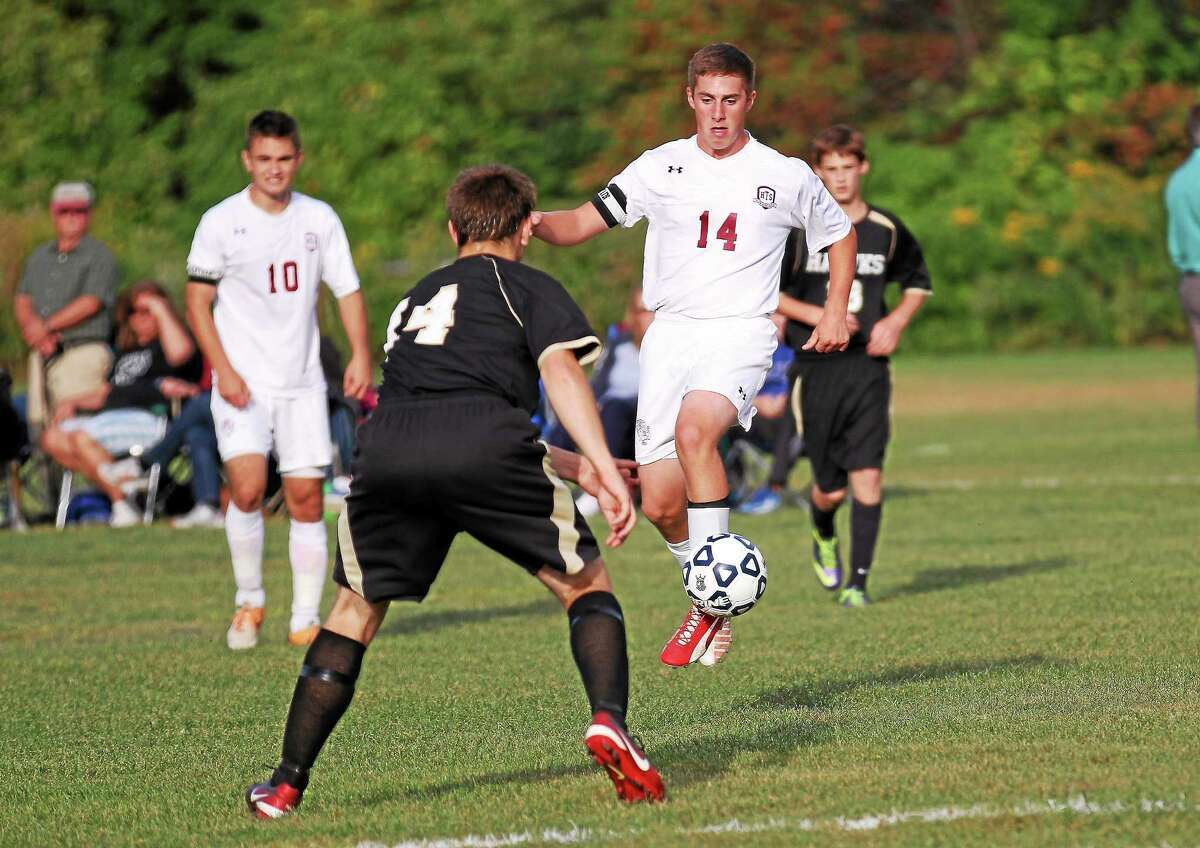 Torringtonís Alex Church controls the ball in the Red Raiders' victory over Woodland Wednesday afternoon