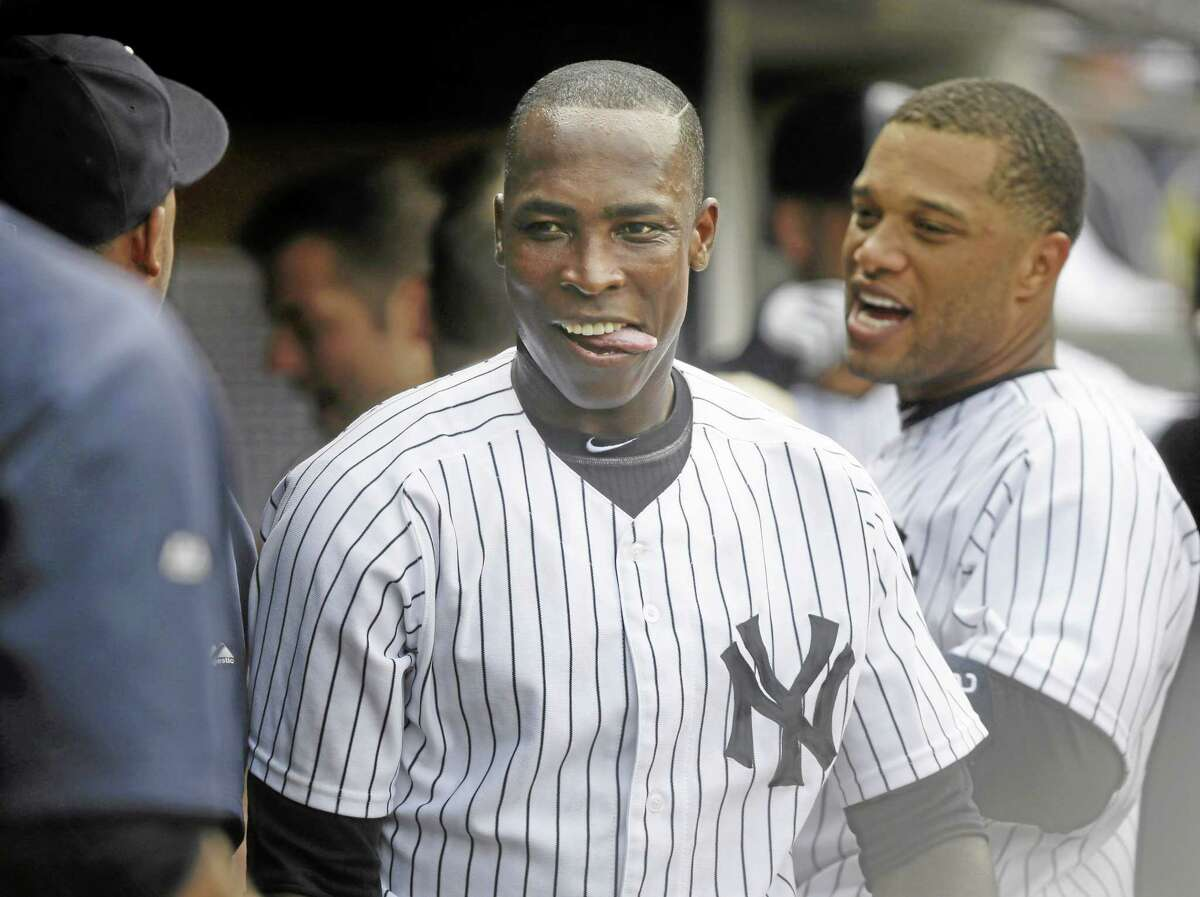 The Yankees' Alfonso Soriano celebrates with teammates in the dugout during New York's eight-run fourth inning against the Chicago White Sox at Yankee Stadium on Monday.
