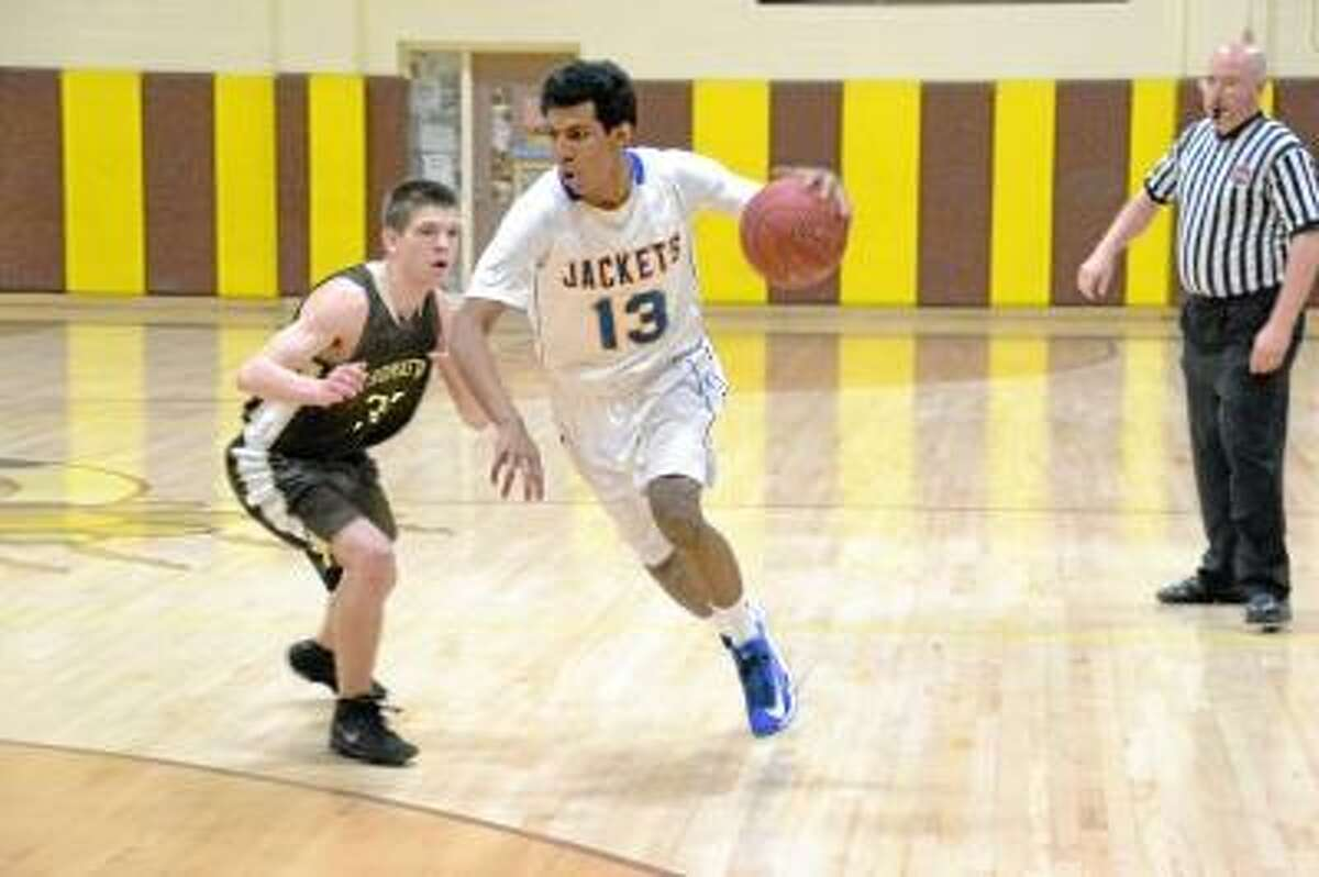 Gilbert's Luis Cordova drives to the basket past Thomaston's Jack Kelley. The Golden Bears defeated the Yellowjackets 58-45. Photo by Pete Paguaga/Register Citizen.