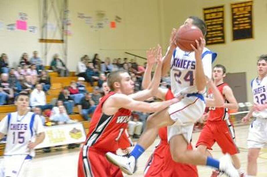 Nonnwaug's Christian Metallo goes up for a layup, while being defended by Wamogo's Matt Rollins. Wamogo defeated Nonnewaug 50-49. Photo by Pete Paguaga/Register Citizen