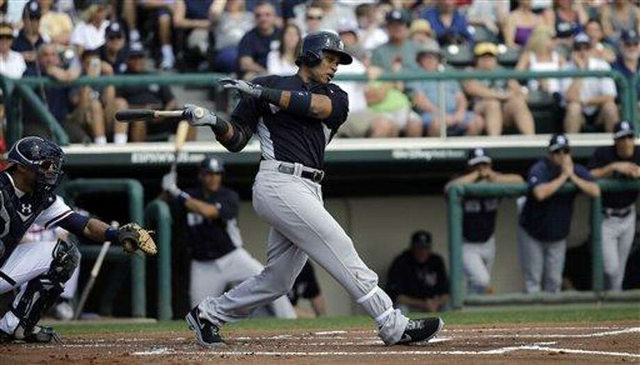 New York Yankees' Robinson Cano bats against the Atlanta Braves during an exhibition spring training baseball game Saturday, Feb. 23, 2013, in Kissimmee, Fla. (AP Photo/David J. Phillip) Photo: ASSOCIATED PRESS / AP2013