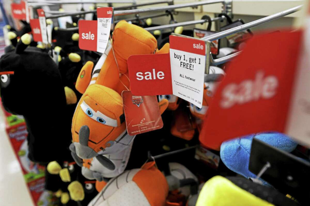 In this Thursday, Nov. 28, 2013 file photo, slippers are sold at a Kmart in New York.