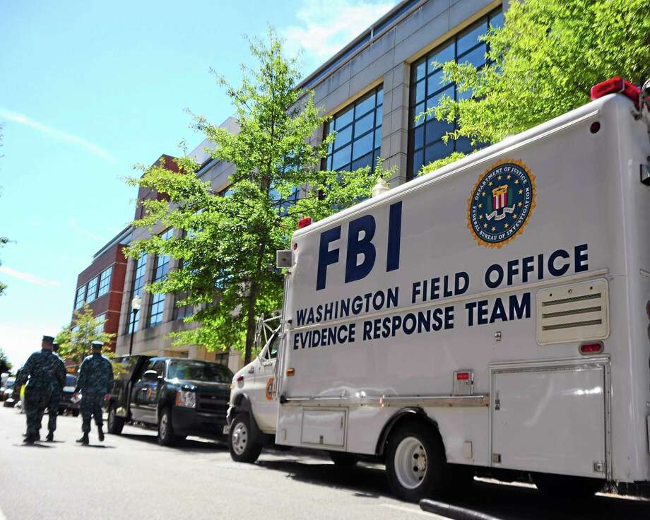 In this photo provided by the U.S. Navy, an FBI evidence response team vehicle is parked outside Building 197 at the Navy Yard in Washington as evidence is collected Wednesday, Sept. 18, 2013. A gunman killed 12 people at the base on Monday, Sept. 16, 2013. (AP Photo/U.S. Navy, Mass Communication Specialist 2nd Class Pedro A. Rodriguez) Photo: AP / U.S. Navy