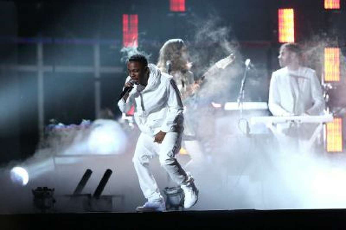In this Jan. 26, 2014 file photo, Kendrick Lamar performs at the 56th annual Grammy Awards at Staples Center, in Los Angeles. Lamar is taking a philosophical approach to being shut out at the Grammy Awards. Lamar, one of Sunday night's top nominees with seven nods, was shut out, prompting four-time winner Macklemore to send a text of apology later that night after winning best rap album.