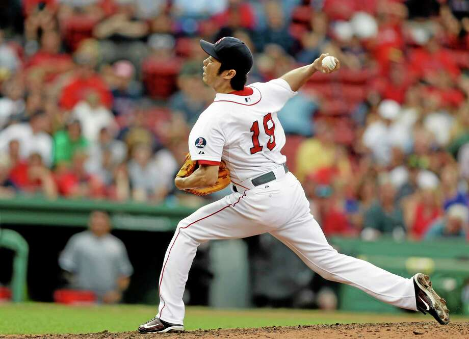 Red Sox closer Koji Uehara delivers a pitch against the White Sox in the ninth inning Sunday. Photo: Steven Senne — The Associated Press  / AP