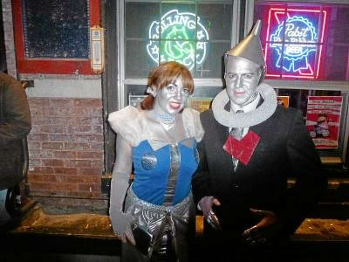 Ryan Flynn/register Citizen Jesse Sythe, dressed as a tinman, and Megan, a robot, were two of the attendees at the Robot Dance Party at Snapper Magee's Saturday night.