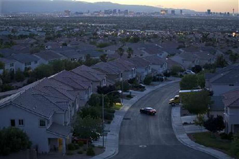 A motorist pulls into the driveway in a neighborhood in Henderson, Nev., one of the states hardest hit by the housing crisis. Photo: AP / AP