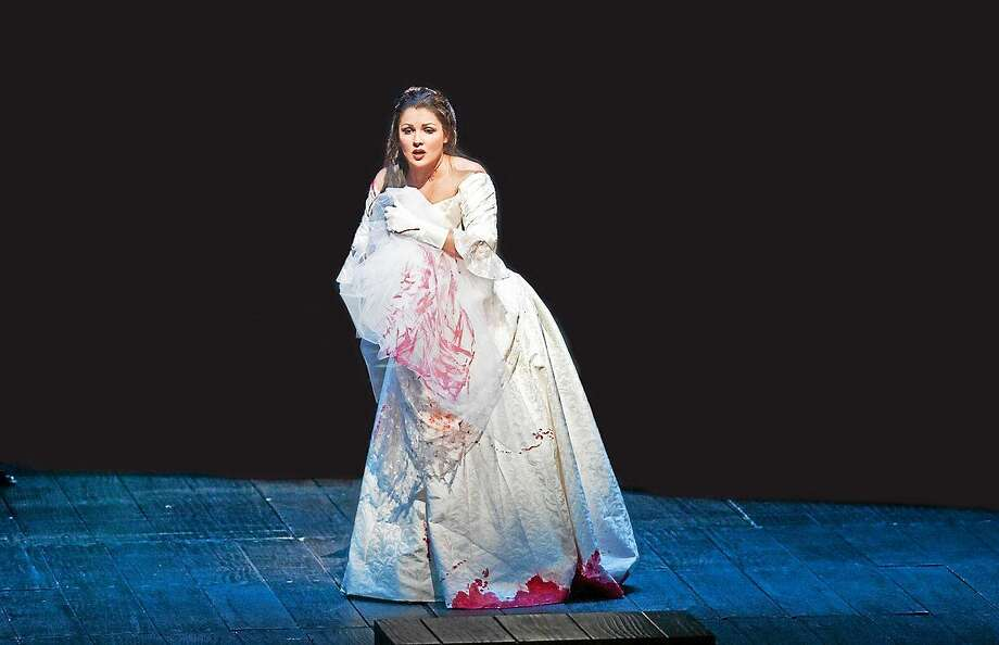Photo courtesy of the Metropolitan Opera Star soprano Anna Netrebko delivers her searing portrayal of Lady Macbeth, the mad and murderous mate of Željko Lučić's doomed Macbeth, for the first time at the Met. See it live in HD at the Warner Theatre in October. Photo: Journal Register Co.