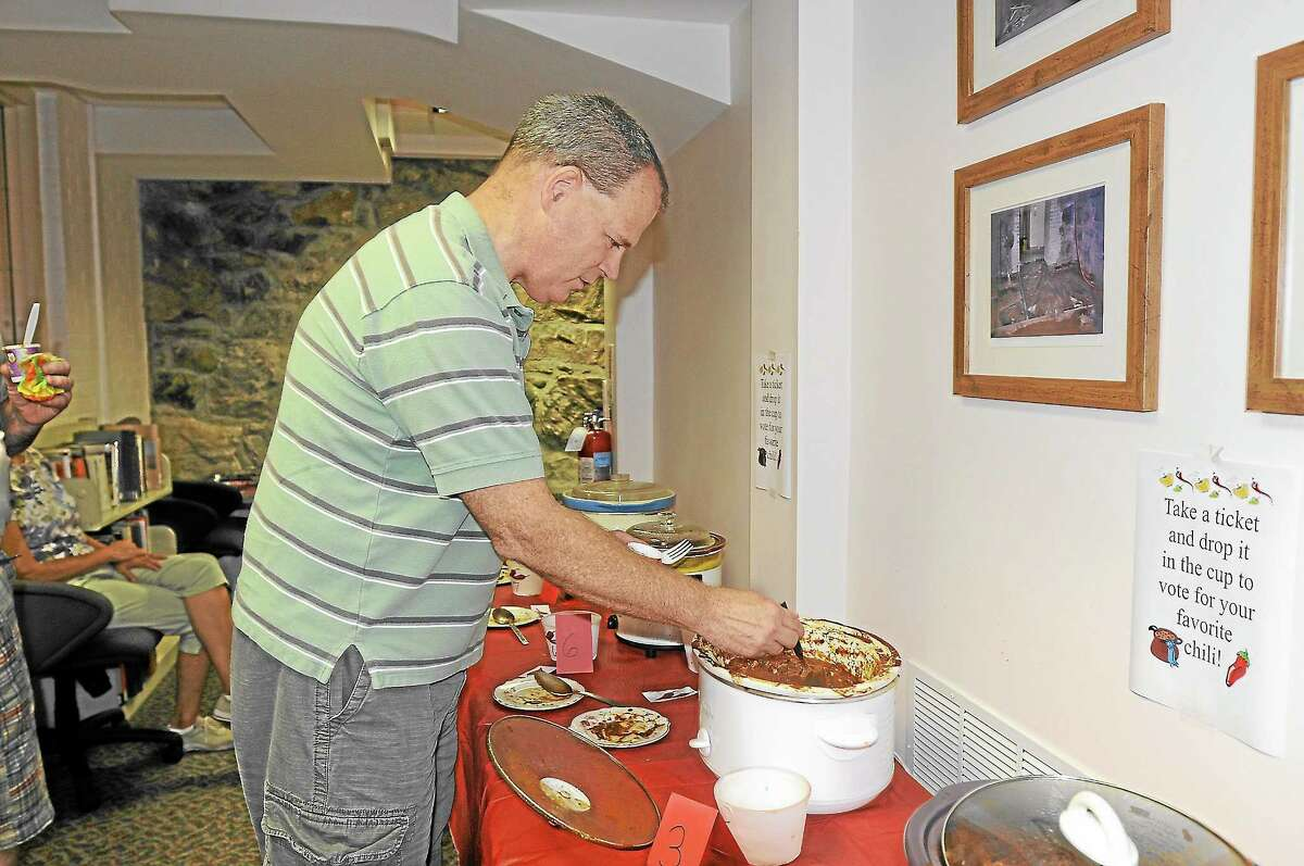 Michael Clarke, of Barkhamsted, eats chili at the Beardsley and Memorial Library on Saturday.