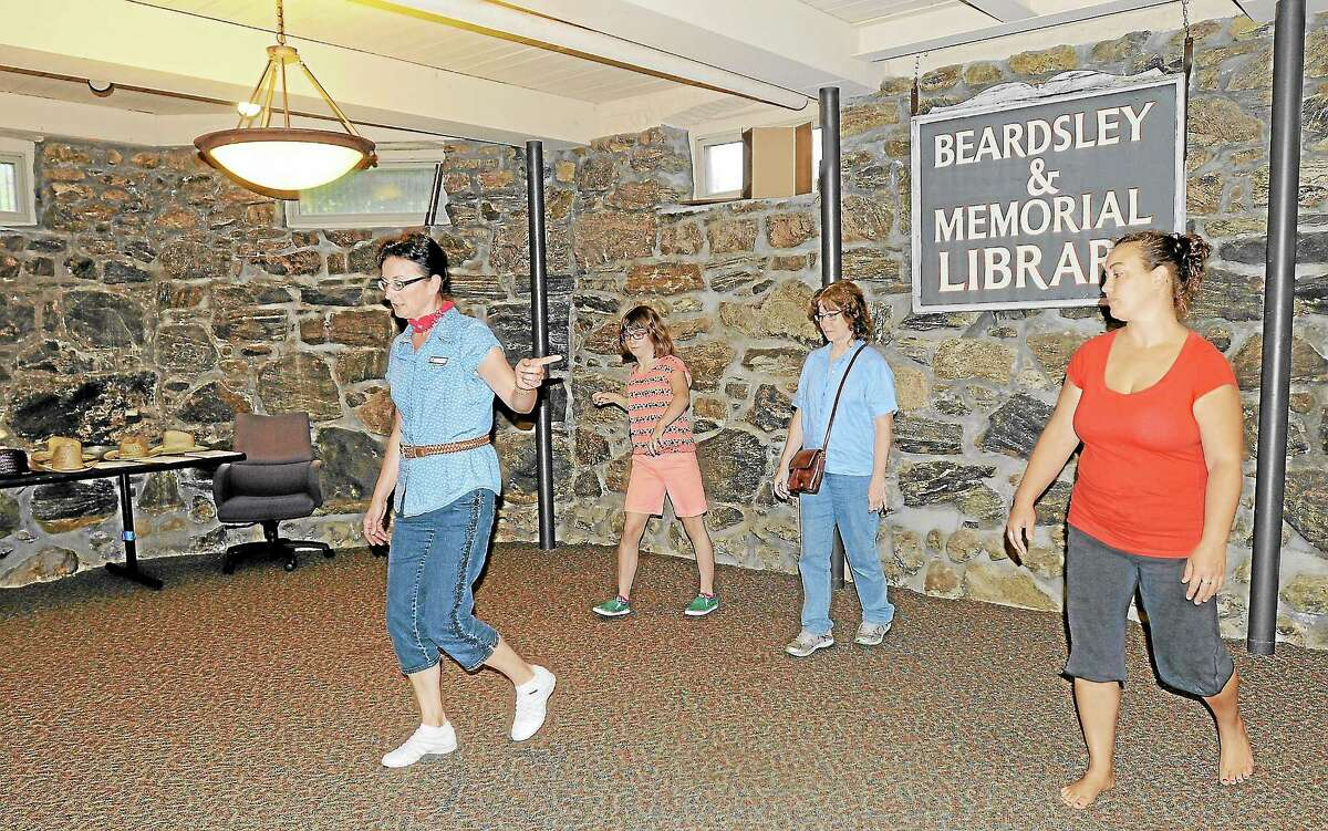Carol Parent leads a line dance class for Rebecca Dowling, Sue Dowling and Bethany Lee.