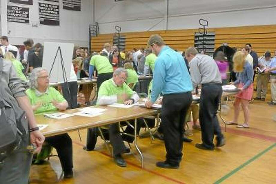 Kate Hartman/Register Citizen -- Students sought financial advise from the over 100 volunteers from the Torrington area.