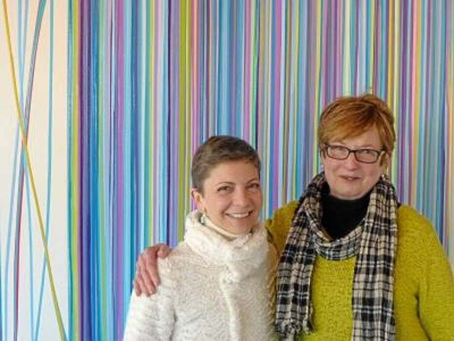 RYAN FLYNN/Register Citizen The Five Points gallery will feature works by artist Jennifer Sabella, left, pictured with Five Points Executive Director Judith McElhone. The women are standing in front of one of Sabella's pieces.