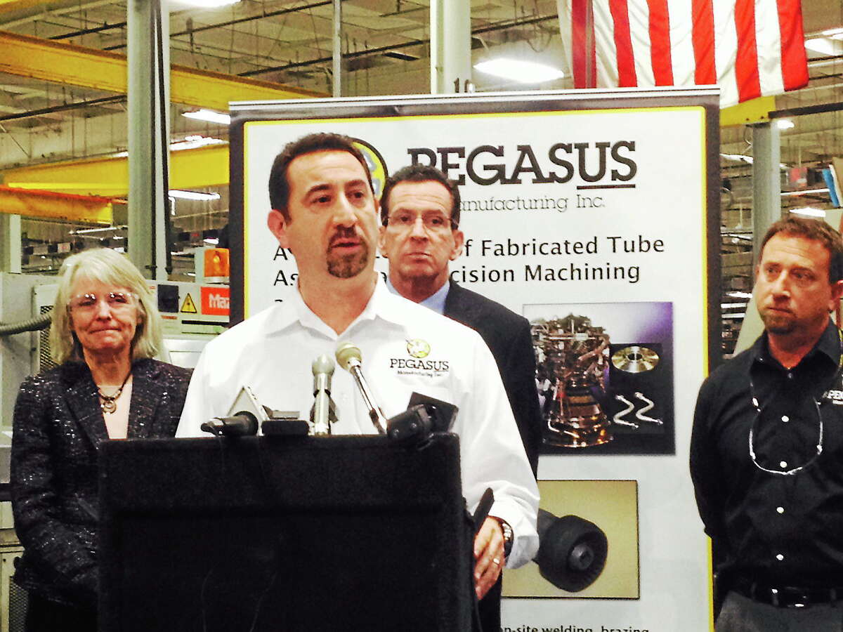 Pegasus Manufacturing President Chris DiPentima speaks on the state government establishing a new Advanced Manufacturing Fund Wednesday to assist state manufacturers as Gov. Dannel P. Malloy looks on.