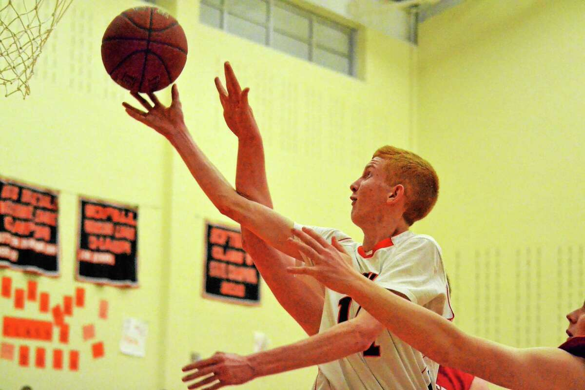 Terryville's Shea Tracy lays in two of his 12 points in the Kangaroos 50-44 win over Northwestern.