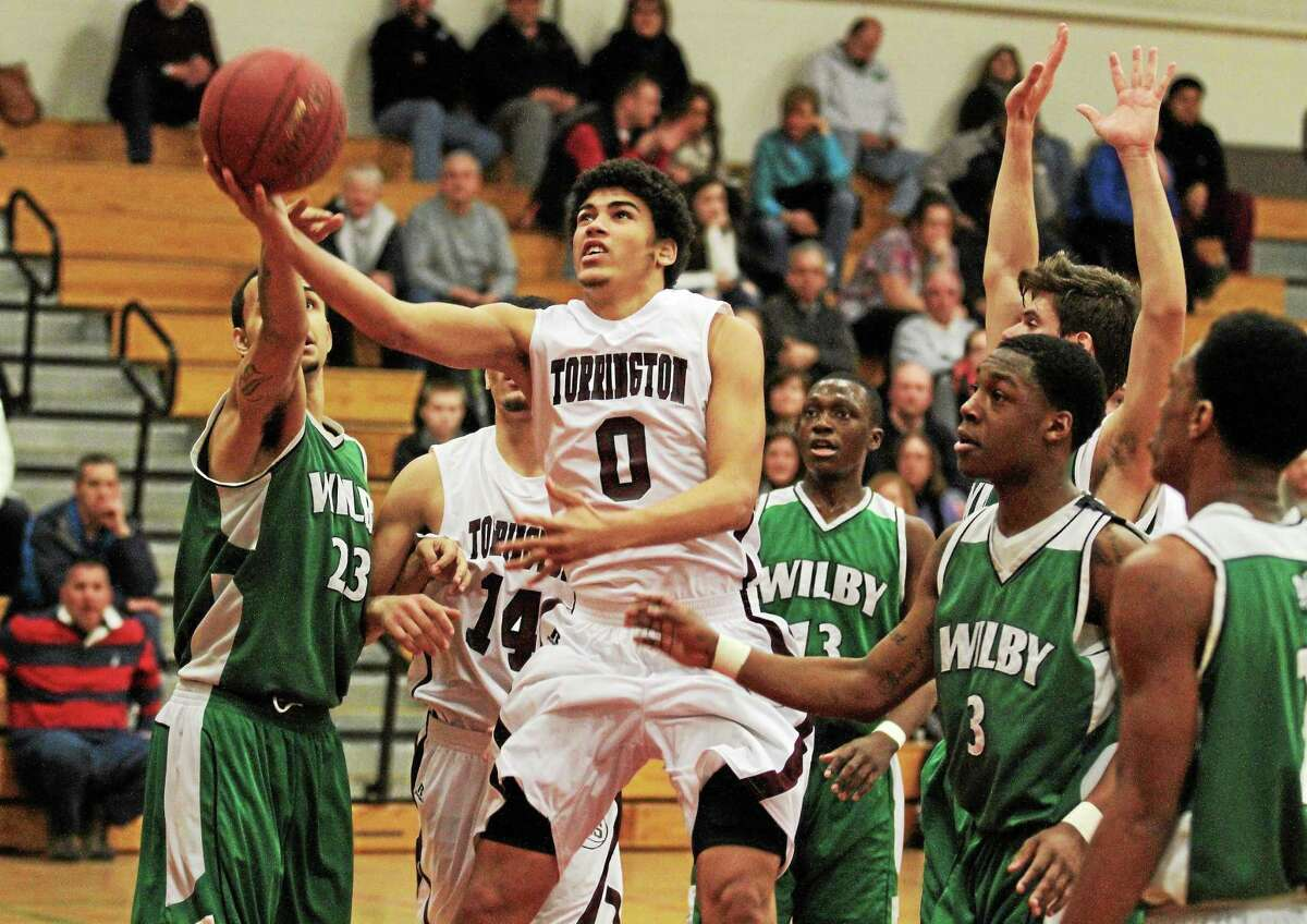 Torrington's Victor Diaz goes for a layup in the Red Raiders 83-77 loss to Wilby. Diaz finished with 8 points.