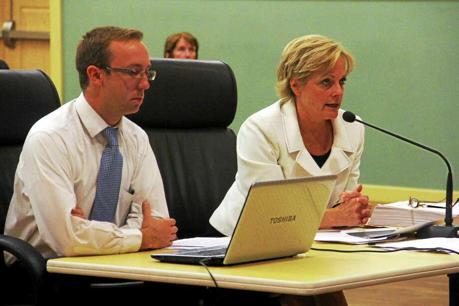 Mayoral aid Tim Waldron (left) sits next to Mayor Elinor Carbone during a presentation regarding a forensic tax audit delivered to the City Council and Board of Finance Wednesday in Torrington. The findings will help the city created new contract language as its current contract with Tax Collector Robert Crovo expires in May. Photo: Esteban L. Hernandez — The Register Citizen