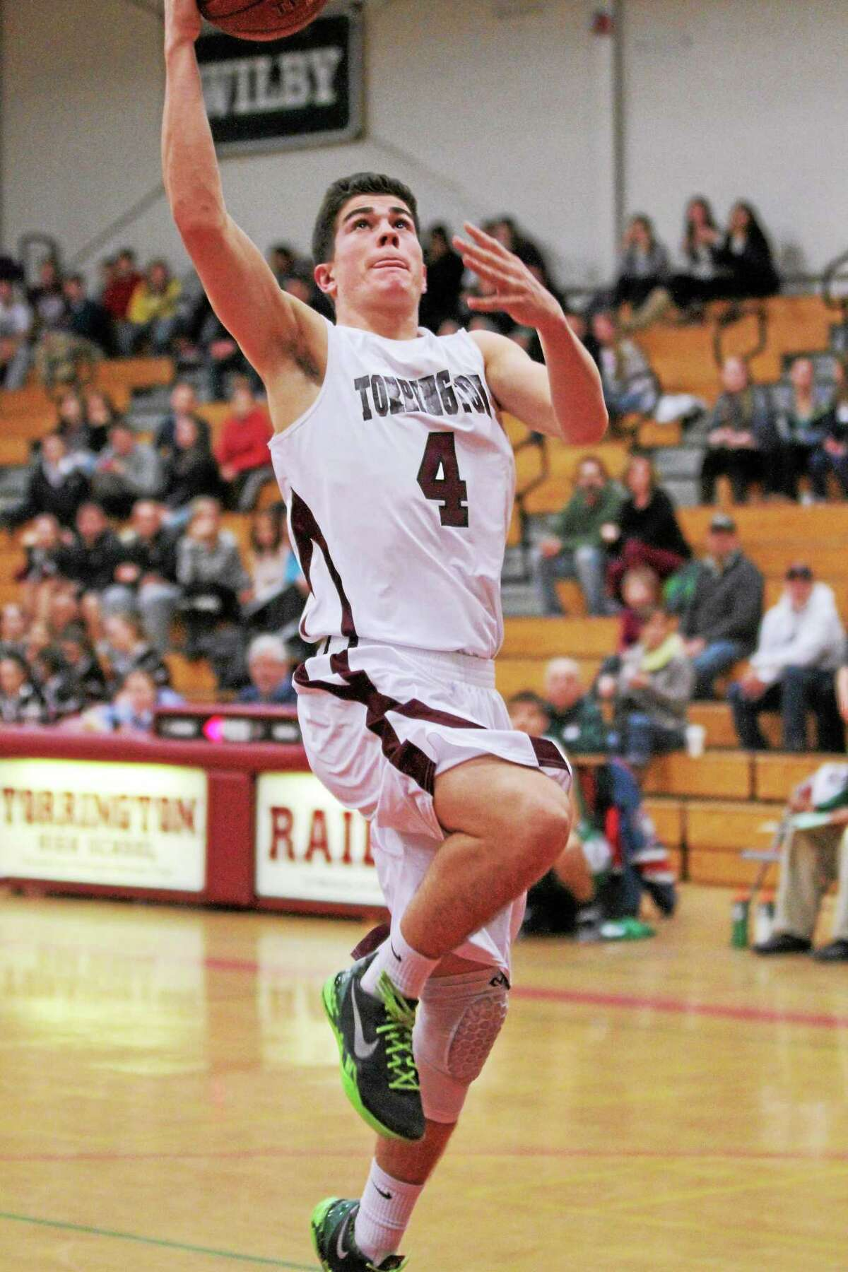 Torrington's John McCarthy lays in two of his team high 18 points in the Red Raiders 83-77 loss to Wilby.