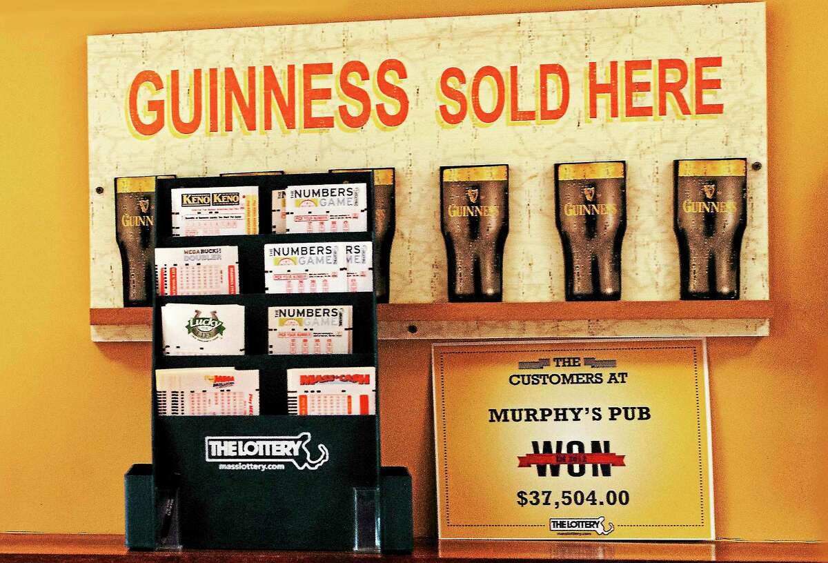 (Melanie Stengel — New Haven Register ) Wagering forms and sign at Murphy's Pub in Agawam 8/14.