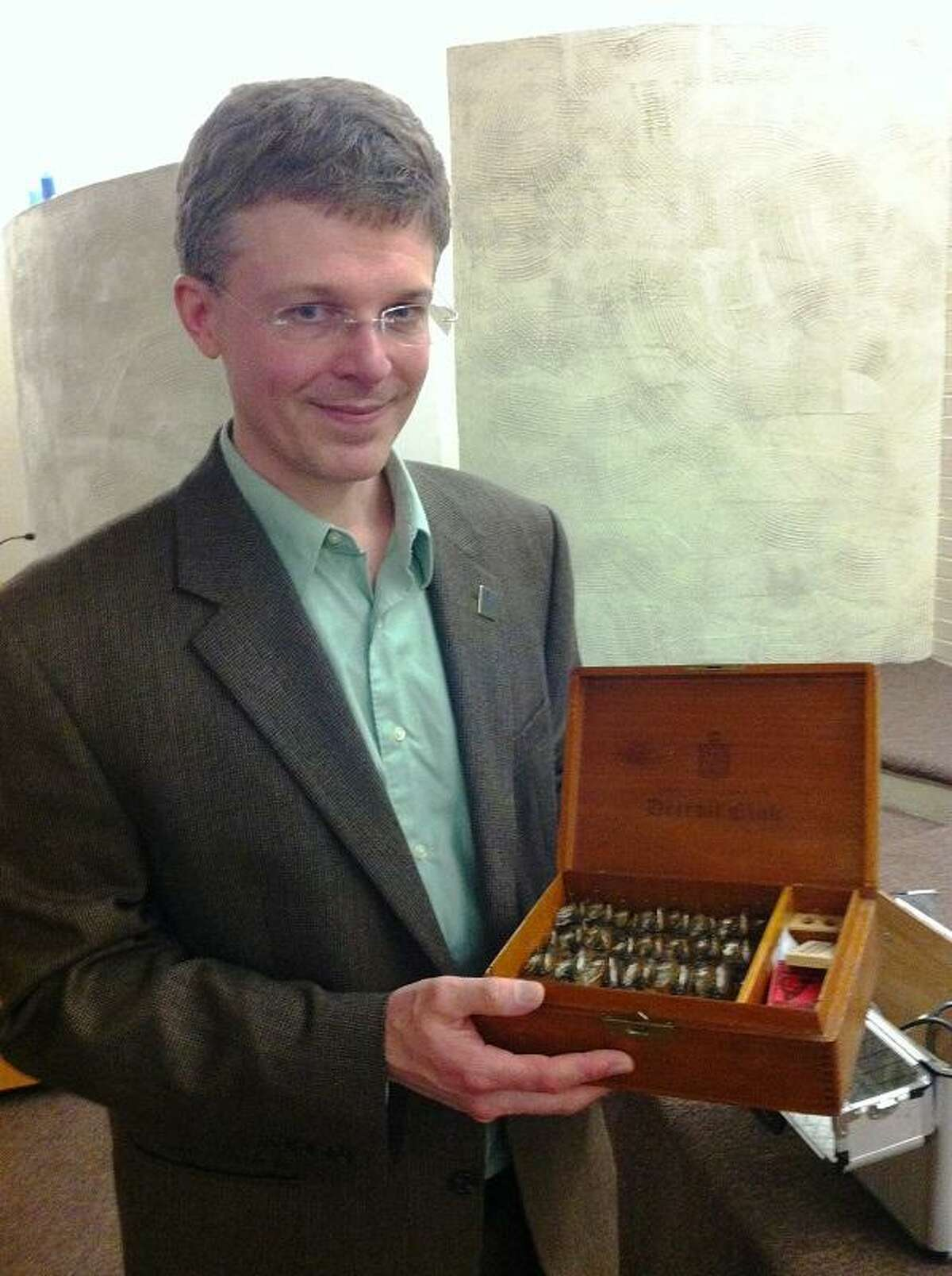 University of Connecticut scientist John Cooley with some of his cicada specimens. Cooley took part in an event at the Yale Peabody Museum of Natural History about this year's return of the 17-year cicada.