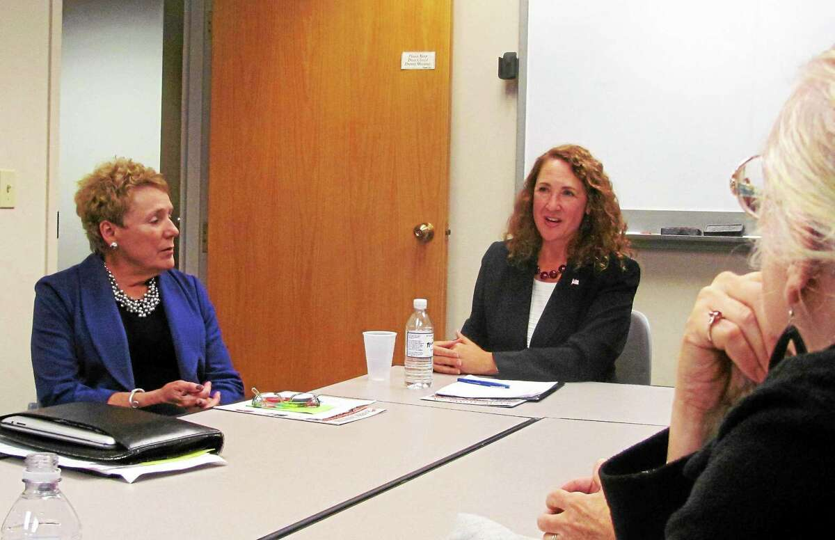 U.S. Rep. Elizabeth Esty, D-5, right, with JoAnn Ryan, president and CEO of Northwest Connecticut's Chamber of Commerce, during a roundtable discussion at the chamber Tuesday.