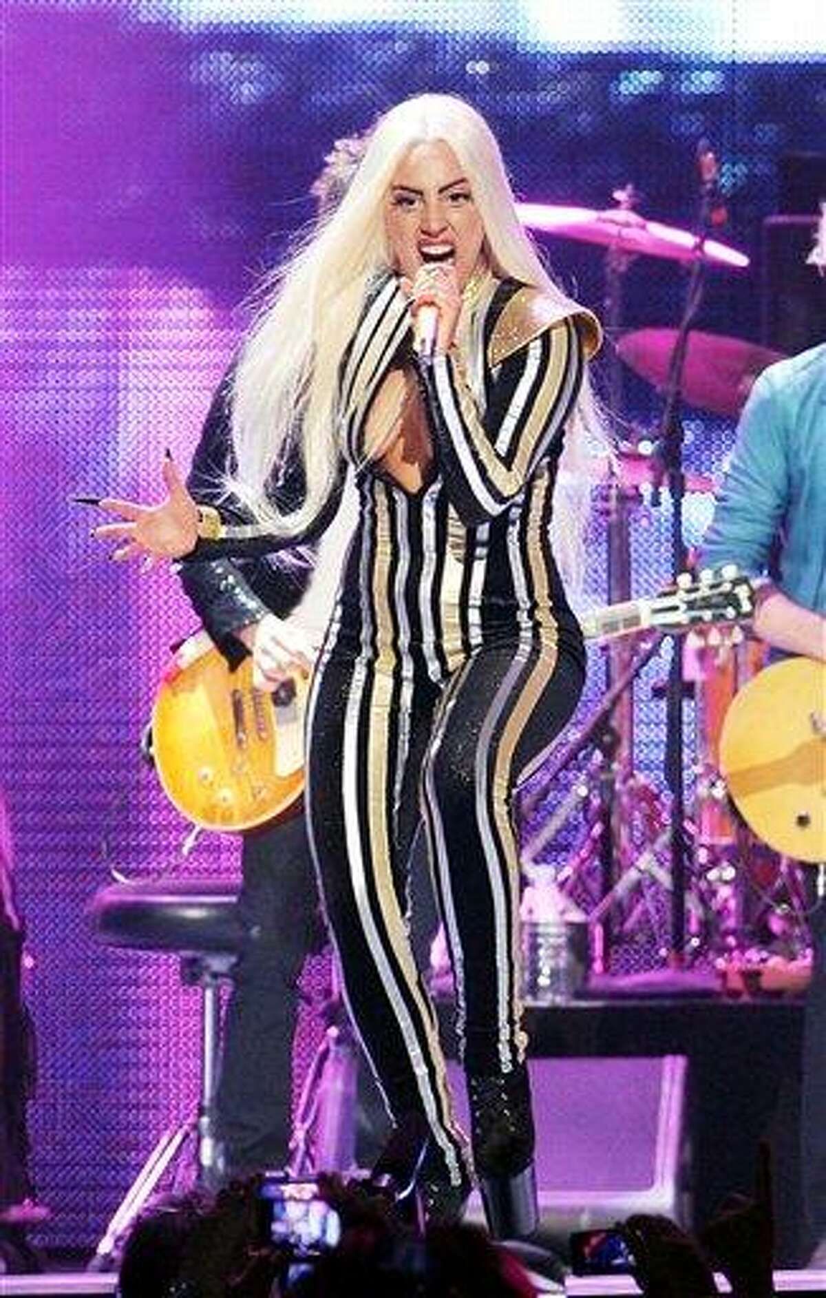 FILE - This Dec. 15, 2012 file photo shows singer Lady Gaga performing at the Prudential Center in Newark, N.J. Lady Gaga says she's completed surgery to fix her hip. The singer posted on her blog late Wednesday that she had hip surgery and that it