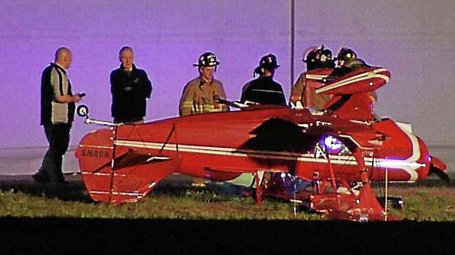 A pilot was extricated after his single-seater plane inverted upon landing at Simsbury Airport on Saturday night, trapping him inside. Photo: Screenshot Via Nbcconnecticut.com
