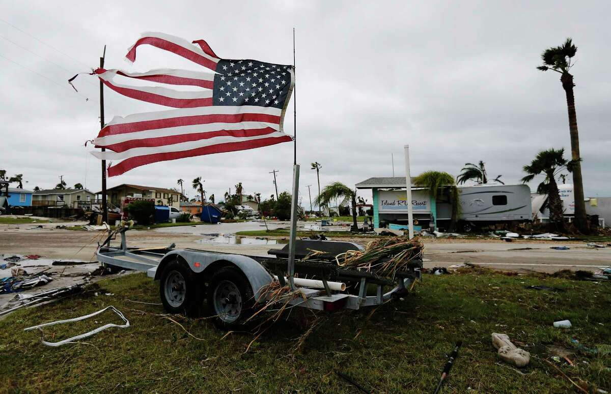 A tattered U.S. flag blows in the wind in the aftermath of Hurricane Harvey in Port Aransas, Texas on Sunday, Aug. 27, 2017.