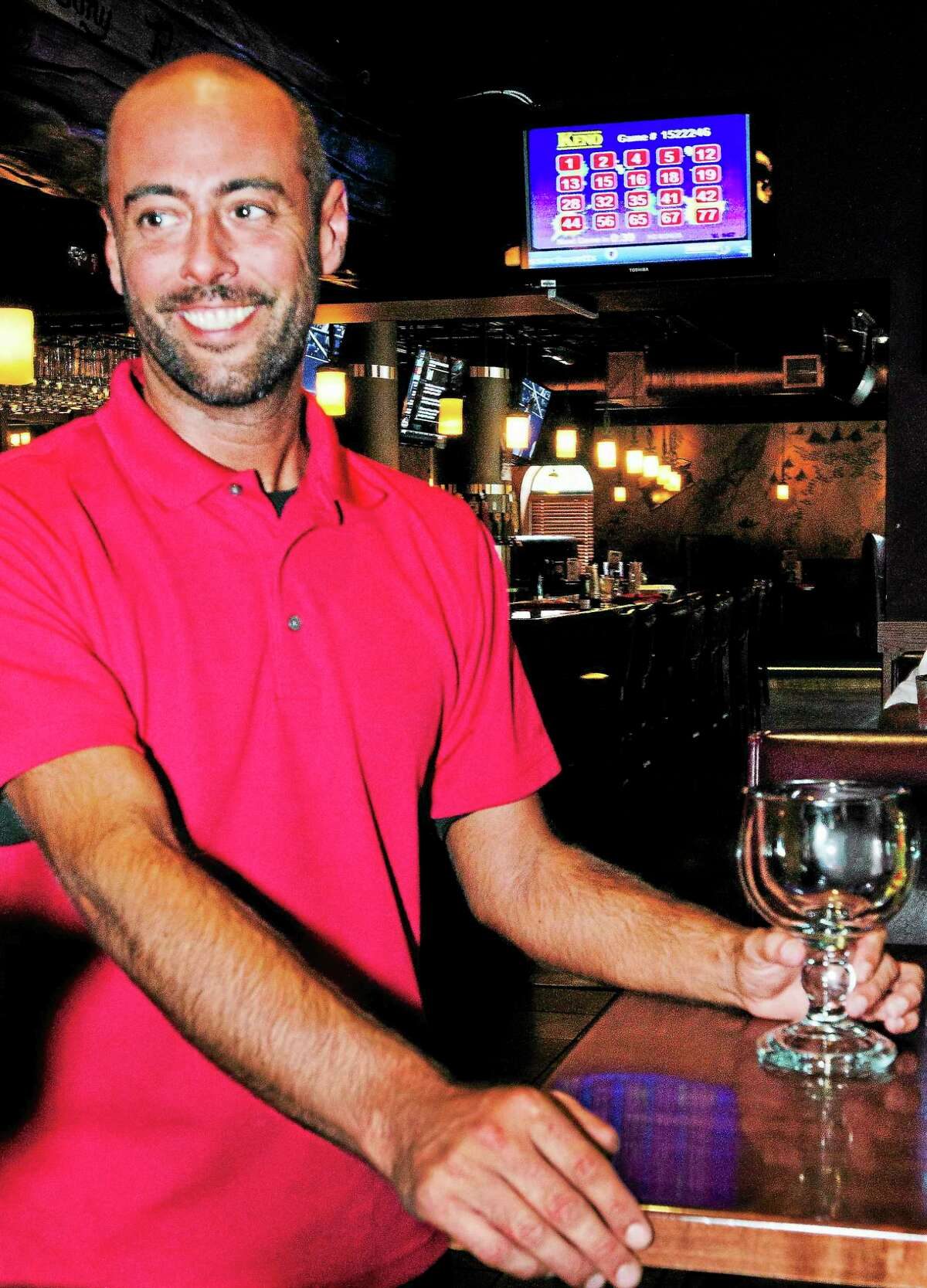 Bartender Ryan Meagher says that Keno is popular at Kaptain Jimmy's in Agawam on Aug. 27.