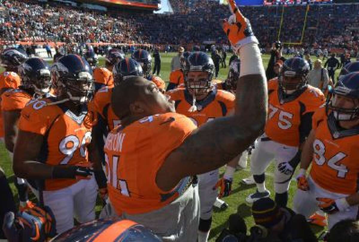 Denver Broncos defensive tackle Terrance Knighton, center, huddles with defensive players on the field before playing against the San Diego Chargers.