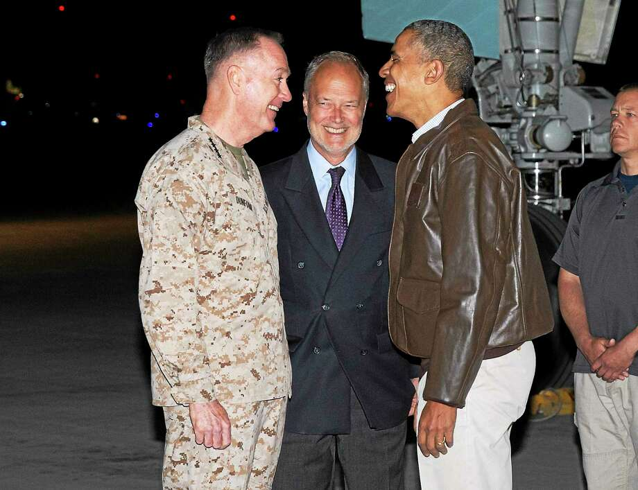 President Barack Obama, right, is greeted by US Ambassador to Afghanistan James Cunningham, center, and Marine General Joseph Dunford, commander of the US-led International Security Assistance Force (ISAF), after arriving at Bagram Air Field for an unannounced visit, on Sunday, May 25, 2014, north of Kabul, Afghanistan. Photo: AP Photo/ Evan Vucci  / AP