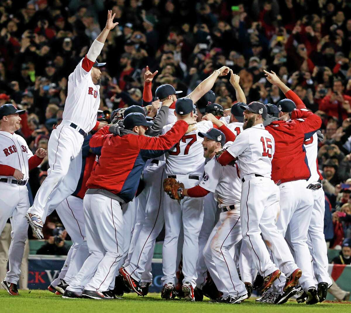 The Boston Red Sox celebrate after defeating the St. Louis Cardinals 6-1 in Game 6 of the World Series on Wednesday night at Fenway Park.