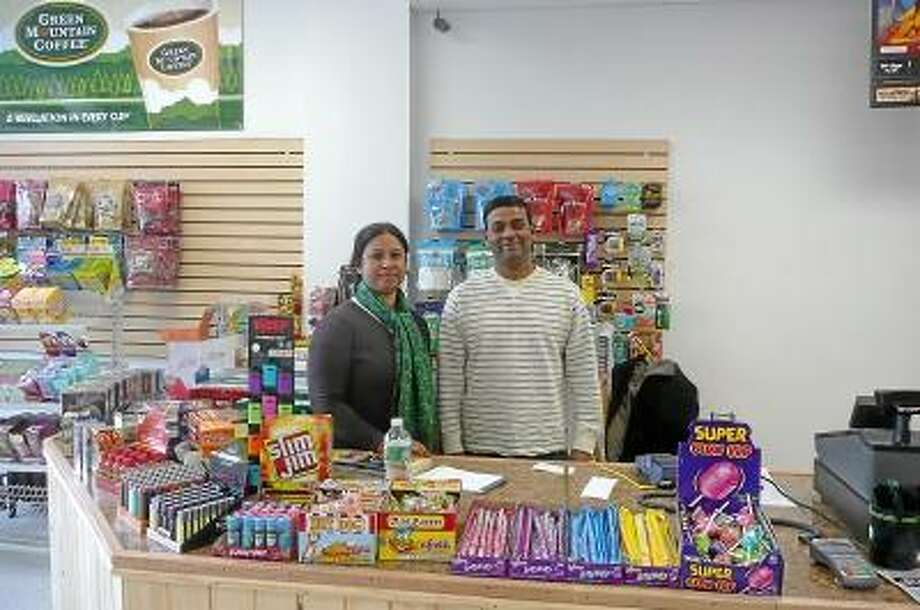 Shahidul Chowdhury and his wife, Tahsina Hoque, opened Shawn's Mini Market on Water Street in Torrington. Kate Hartman/Register Citizen.