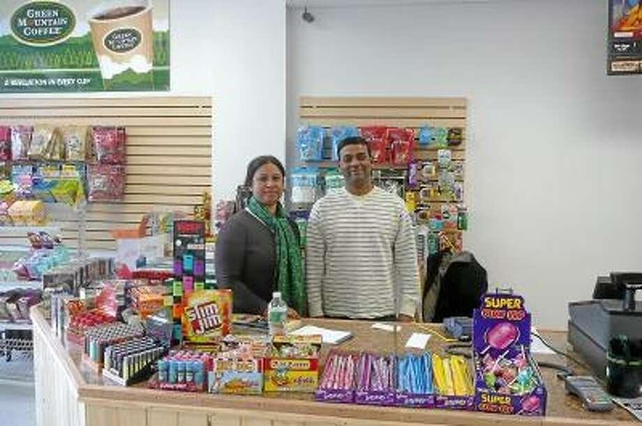 Shahidul Chowdhury and his wife, Tahsina Hoque, opened Shawn's Mini Market on Water Street in Torrington. Kate Hartman/Register Citizen.