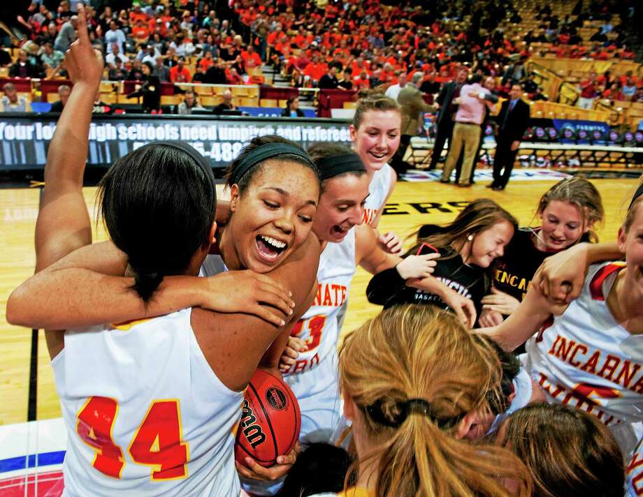 Incarnate Word's Gwen Adams (44) is hugged by Napheesa Collier after they defeated Dexter 60-43 in the Class 4 state championship game on March 22 in Columbia, Missouri. Photo: L.G. Patterson — The Associated Press  / AP2014