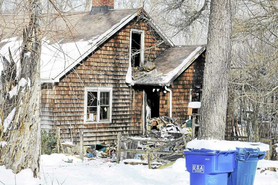 A house on Chapin Road was significantly damaged by a fire early Tuesday morning, Jan. 28, 2014. A cat was killed in the blaze. Photo: Laurie Gaboardi — Register Citizen