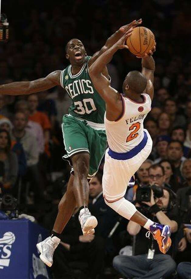 Boston Celtics forward Brandon Bass (30) blocks a shot by New York Knicks guard Raymond Felton (2) in the second half of Game 5 of their first-round NBA basketball playoff series at Madison Square Garden in New York, Wednesday, May 1, 2013. The Celtics won 92-86. (AP Photo/Kathy Willens) Photo: AP / AP