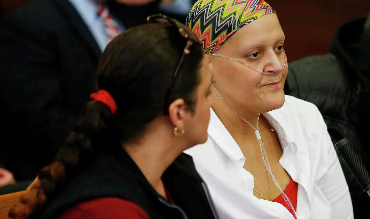 """Tanya Singleton, right, a cousin of former New England Patriots tight end Aaron Hernandez, sits beside her sister, Jennifer """"Gina"""" Valderrama Mercado, in court in Suffolk Superior Court on Tuesday in Boston. Singleton pleaded guilty to a contempt charge for refusing to testify before the grand jury that indicted Hernandez in the 2012 killings of two Boston men. She was sentenced to two years of probation."""